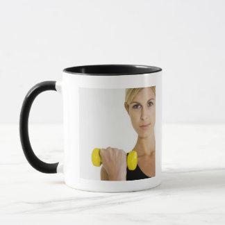 Woman with hand weight mug