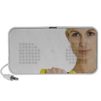 Woman with hand weight portable speaker