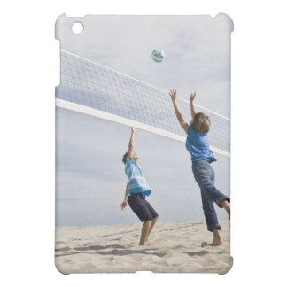 Woman with her grandson playing beach volleyball iPad mini case