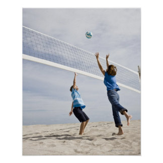 Woman with her grandson playing beach volleyball poster