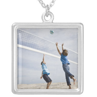 Woman with her grandson playing beach volleyball silver plated necklace