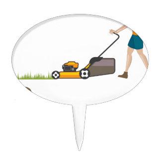 Woman with lawnmower cake picks