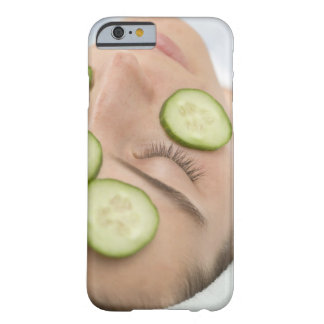 Woman with slices of fresh cucumber on her face, barely there iPhone 6 case