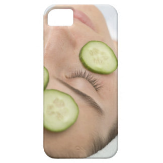 Woman with slices of fresh cucumber on her face, iPhone 5 cover