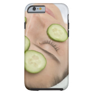 Woman with slices of fresh cucumber on her face, tough iPhone 6 case
