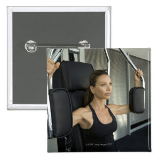 Woman working out in a gym 15 cm square badge