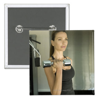 Woman working out in a gym 2 15 cm square badge