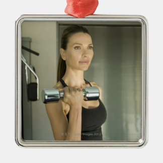 Woman working out in a gym 2 Silver-Colored square decoration