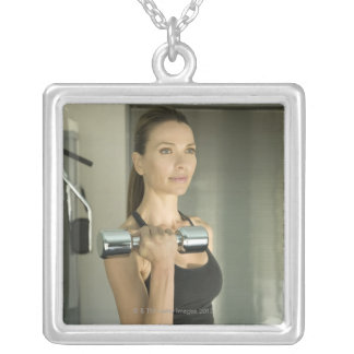 Woman working out in a gym 2 silver plated necklace