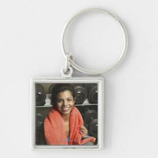 Woman working out Silver-Colored square key ring