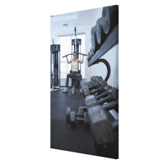 Woman working out with weights 2 canvas prints