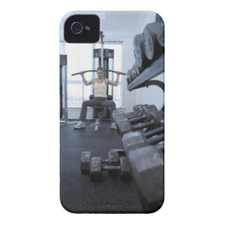 Woman working out with weights 2 iPhone 4 case