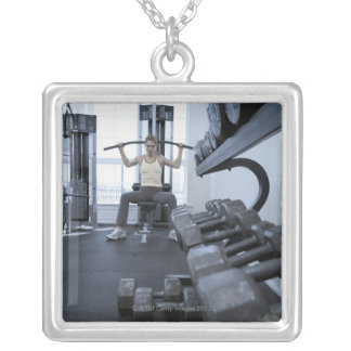 Woman working out with weights 2 custom jewelry