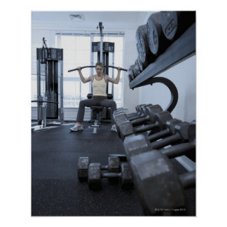 Woman working out with weights 2 poster