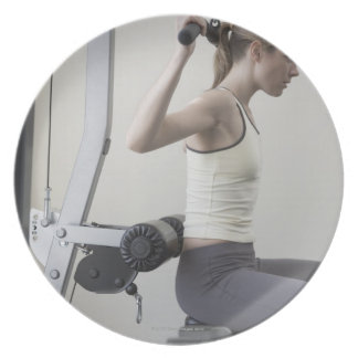 Woman working out with weights plate