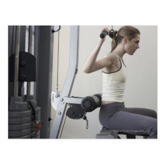 Woman working out with weights postcard
