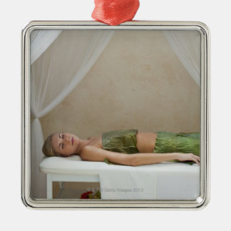 Woman wrapped in banana leaves at a spa in christmas ornament