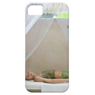 Woman wrapped in banana leaves at a spa in iPhone 5 covers