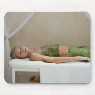 Woman wrapped in banana leaves at a spa in mouse mat