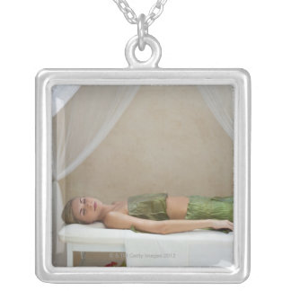 Woman wrapped in banana leaves at a spa in silver plated necklace