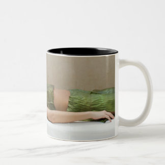 Woman wrapped in banana leaves at a spa in Two-Tone coffee mug