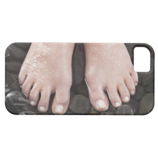 Woman's feet on pebbles iPhone 5 cases
