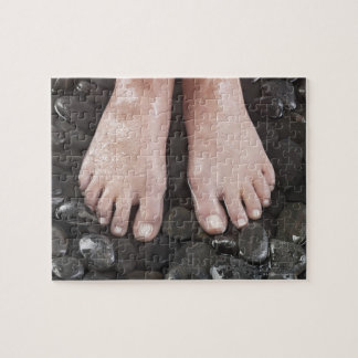 Woman's feet on pebbles jigsaw puzzle