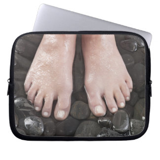 Woman's feet on pebbles laptop sleeve