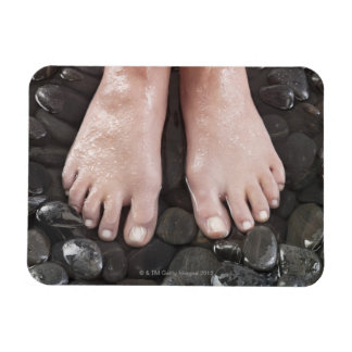 Woman's feet on pebbles magnet