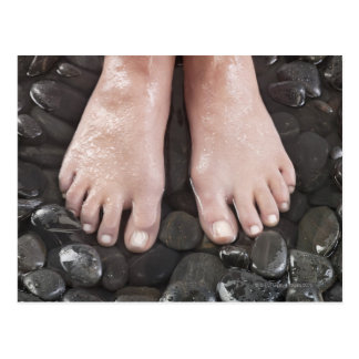 Woman's feet on pebbles postcard