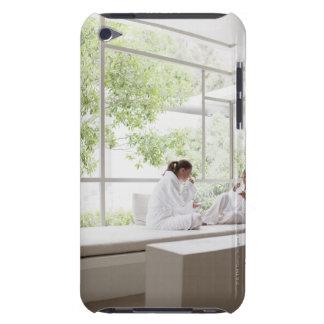 Women drinking tea in window iPod Case-Mate case