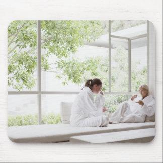 Women drinking tea in window mouse mat