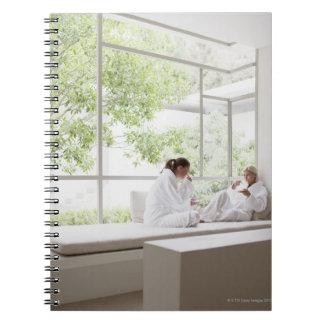 Women drinking tea in window notebook