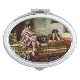 Women Friends in a Harem Makeup Mirror