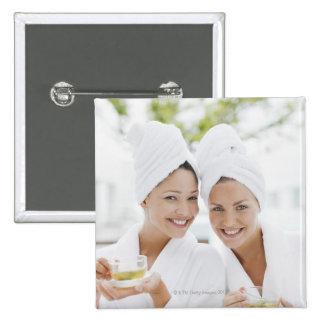 Women in bathrobes drinking tea at spa 15 cm square badge