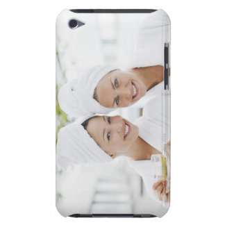 Women in bathrobes drinking tea at spa barely there iPod cover