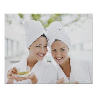 Women in bathrobes drinking tea at spa poster
