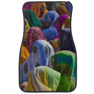 Women in colorful saris gather together car mat