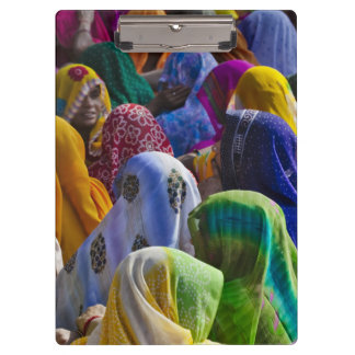 Women in colorful saris gather together clipboard