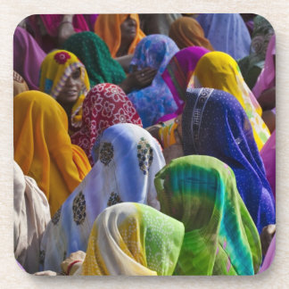 Women in colorful saris gather together coaster