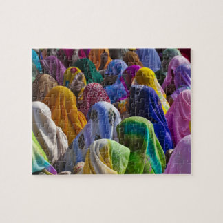 Women in colorful saris gather together jigsaw puzzle
