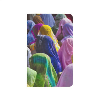Women in colorful saris gather together journal