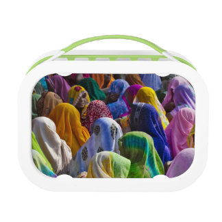 Women in colorful saris gather together lunch box