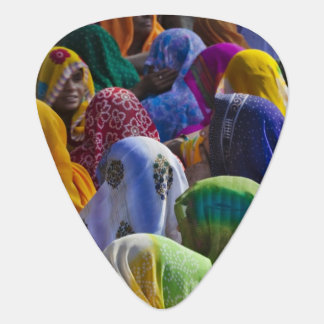 Women in colorful saris gather together plectrum