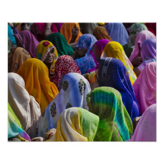 Women in colorful saris gather together poster