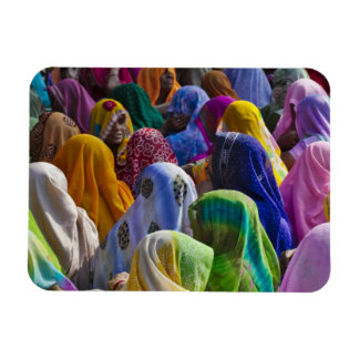 Women in colorful saris gather together rectangular photo magnet