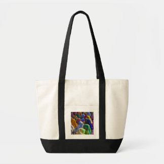 Women in colorful saris gather together tote bag