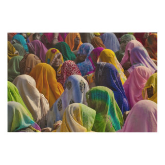 Women in colorful saris gather together wood wall decor