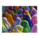 Women in colourful saris gather together postcard