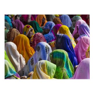 Women in colourful saris gather together post cards
